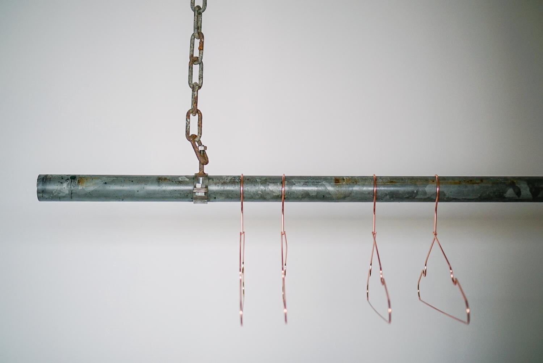 Industrial coat hanger with copper hanger
