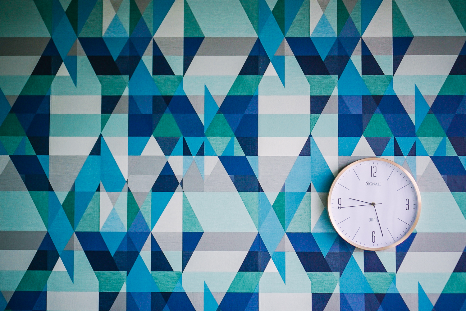Geometrical wallpaper with copper clock